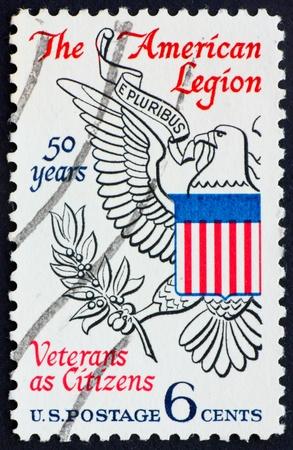 UNITED STATES OF AMERICA - CIRCA 1969: a stamp printed in the United States of America shows Eagle from Great seal of U.S., 50th anniversary of American Legion, circa 1969 Stock Photo - 10514137