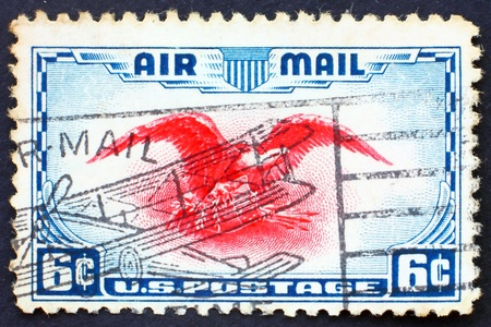 airmail: UNITED STATES OF AMERICA - CIRCA 1938: a stamp printed in the United States of America shows Eagle holding shield, olive branch and arrows, circa 1938