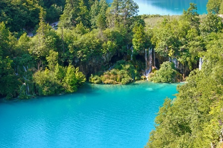 Summer landscape with beautiful waterfalls in the Plitvice Lakes in Croatia photo