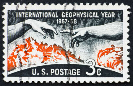geophysical: UNITED STATES OF AMERICA - CIRCA 1958: a stamp printed in the United States of America shows Solar disc and hands from Michelangelo�s Creation of Adam, International Geophysical year 1957-58, circa 1958