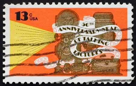 UNITED STATES OF AMERICA - CIRCA 1977: a stamp printed in the United States of America shows Movie projector and phonograph, 50th Anniversary of Talking picture, circa 1977 photo