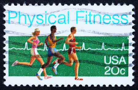 UNITED STATES OF AMERICA - CIRCA 1983: a stamp printed in the United States of America shows the people who run, physical fitness, circa 1983 Stock Photo - 10684896