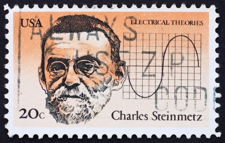 alternating: UNITED STATES OF AMERICA - CIRCA 1983: a stamp printed in the United States of America shows Charles Steinmetz and chart of alternating current, American inventor, circa 1983