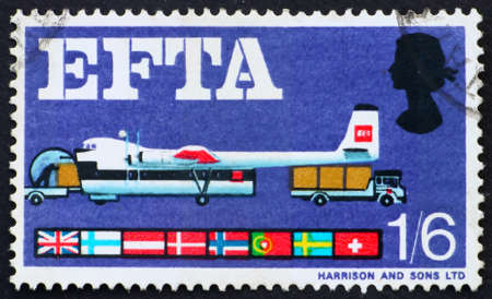 GREAT BRITAIN � CIRCA 1967: a stamp printed in the Great Britain shows loading plane from trucks and flags of EFTA members, circa 1967 photo