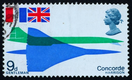 GREAT BRITAIN � CIRCA 1969: a stamp printed in the Great Britain shows Concorde seen from above and from side and flags of France and Great Britain, circa 1969 photo