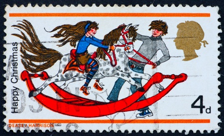 GREAT BRITAIN � CIRCA 1978: a stamp printed in the Great Britain shows Boy and Girl playing with Rocking Horse, circa 1978 photo