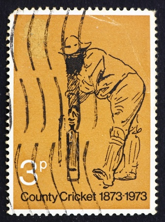 cricketer: GREAT BRITAIN � CIRCA 1973: a stamp printed in the Great Britain shows Picture of William Gilbert Grace, the Great Cricketer, by Harry Furniss, circa 1973