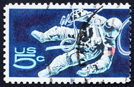 UNITED STATES OF AMERICA - CIRCA 1967: a stamp printed in the United States of America shows Space-Walking Astronaut, circa 1967 Stock Photo - 10898381