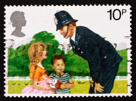 constable: GREAT BRITAIN - CIRCA 1979: a stamp printed in the Great Britain shows Police Constable and Children, 150th anniversary of London Metropolitan Police, circa 1979