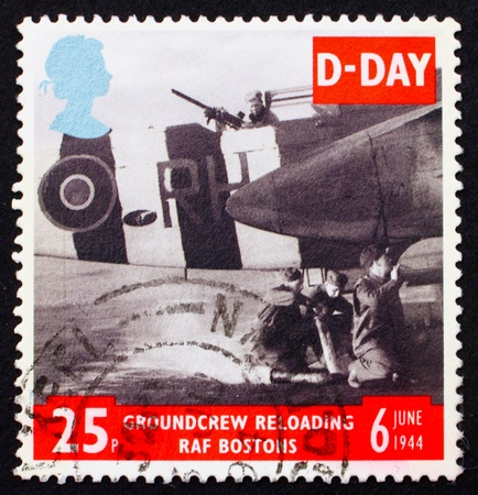 GREAT BRITAIN - CIRCA 1994: a stamp printed in the Great Britain shows Ground Crew reloading FAF Bostons, 50th anniversary of D-Day, circa 1994 photo