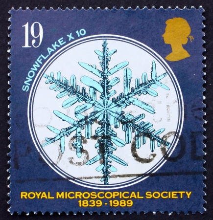 microscopical: GREAT BRITAIN - CIRCA 1989: a stamp printed in the Great Britain shows Snowflake under Microscope, 150th anniversary of Royal Microscopical Society, circa 1989