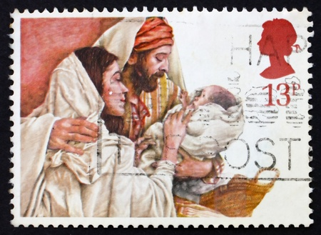 gilbert: GREAT BRITAIN - CIRCA 1985: a stamp printed in the Great Britain shows Holy Family by Yvonne Gilbert, circa 1985