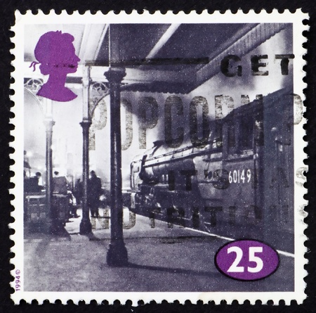 GREAT BRITAIN - CIRCA 1996: a stamp printed in the Great Britain shows Locomotive at King Cross Station, London, circa 1996 photo