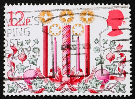 GREAT BRITAIN - CIRCA 1980: a stamp printed in the Great Britain shows Candles, ivy, ribbons, Traditional Decorations for Christmas, circa 1980 photo