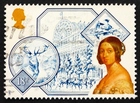 accession: REAT BRITAIN - CIRCA 1987: a stamp printed in the Great Britain shows Portrait of Queen Victoria and Great Exhibition at Crystal Palace (1851), 150th Anniversary of Accession of Queen Victoria, circa 1987 Editorial