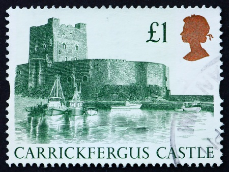 GREAT BRITAIN - CIRCA 1988: a stamp printed in the Great Britain shows Carrickfergus Castle, circa 1988 Stock Photo - 11190423