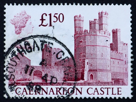 GREAT BRITAIN - CIRCA 1988: a stamp printed in the Great Britain shows Caernarfon Castle, circa 1988 Stock Photo - 11190425