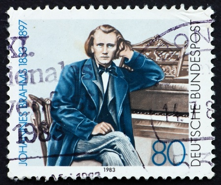 instrumentalist: GERMANY - CIRCA 1983: a stamp printed in the Germany shows Johannes Brahms, Composer, circa 1983