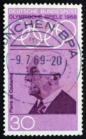coubertin: GERMANY - CIRCA 1968: a stamp printed in the Germany shows Pierre de Coubertin, founder of the International Olympic Committee, circa 1968