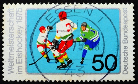 GERMANY - CIRCA 1975: a stamp printed in the Germany shows Ice Hockey, Ice Hockey World Championship, Munich and Dusseldorf, circa 1975 photo