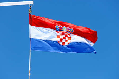 Croatian flag on the ship in front of the blue sky photo