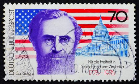 GERMANY - CIRCA 1976: a stamp printed in the Germany shows Carl Schurz who Became first German-born American Elected to the US Senate, American Flag and Capitol, American Bicentennial, circa 1976 Stock Photo - 11278293