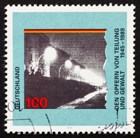 GERMANY - CIRCA 1995: a stamp printed in the Germany shows Berlin Wall, Victims of a Divided Germany, circa 1995 photo