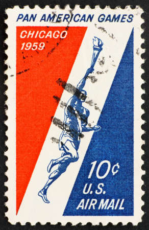 UNITED STATES OF AMERICA - CIRCA 1959: a stamp printed in the United States of America shows Runner Holding Torch, 3rd Pan American Games, Chicago, circa 1959 photo