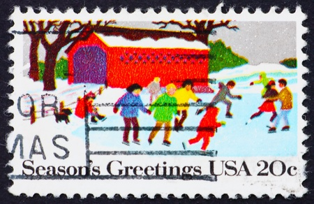 UNITED STATES OF AMERICA - CIRCA 1982: a stamp printed in the United States of America shows People Skating, Christmas, circa 1982 photo