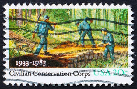 civilian: UNITED STATES OF AMERICA - CIRCA 1983: a stamp printed in the United States of America shows People Working in Forest, Civilian Conservation Corps, circa 1983 Stock Photo