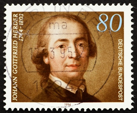 theologian: GERMANY - CIRCA 1994: a stamp printed in the Germany shows Johann Gottfried Herder, Theologian, circa 1994 Stock Photo