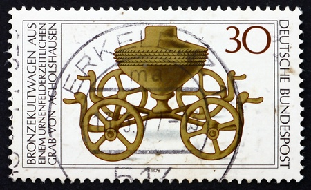 GERMANY - CIRCA 1976: a stamp printed in the Germany shows Bronze Ritual Chariot c. 1000 B.C., Archaeological Treasures, circa 1976 photo