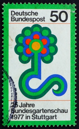 GERMANY - CIRCA 1977: a stamp printed in the Germany shows Flower Show Emblem, Federal Horticultural Show, Stuttgart, circa 1977 photo