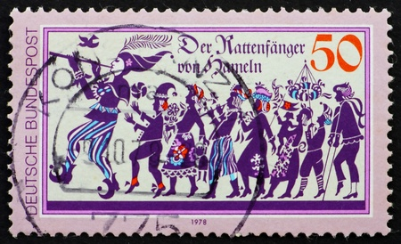 GERMANY - CIRCA 1978: a stamp printed in the Germany shows Pied Piper of Hamelin who led 130 Children of Hamelin Away Never to be Seen Again, circa 1978 photo