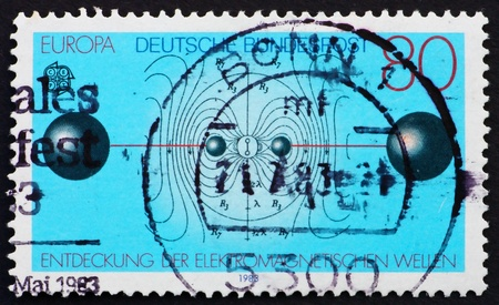 hertz: GERMANY - CIRCA 1983: a stamp printed in the Germany shows Resonant Circuit, Electric Flux Lines, Discovery of Electromagnetic Waves by Heinrich Hertz, circa 1983
