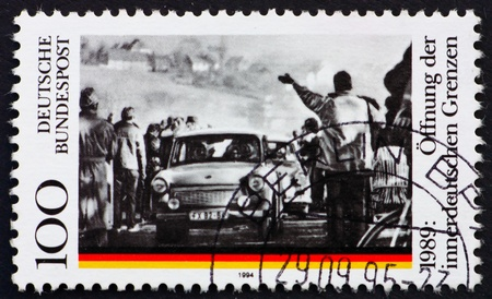 cancelled stamp: GERMANY - CIRCA 1995: a stamp printed in the Germany shows Opening of the Berlin Wall, 5th Anniversary, circa 1995