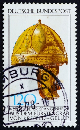 GERMANY - CIRCA 1977: a stamp printed in the Germany shows Gilt Helmet from Prince�s Tomb, Krefeld-Gellep, Archaeological heritage, circa 1977 photo