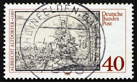 engraver: GERMANIA - CIRCA 1980: un francobollo stampato in Germania mostra Paesaggio con abeti, di Albrecht Altdorfer, pittore e incisore, circa 1980