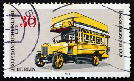 GERMANY - CIRCA 1973: a stamp printed in the Germany shows Double-Decker Bus, about 1919, circa 1973 photo