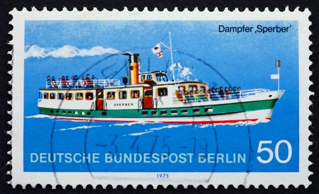 GERMANY - CIRCA 1975: a stamp printed in the Germany shows Steamship Sperber, Berlin Passenger Ship, circa 1975 photo