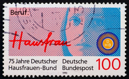 GERMANY - CIRCA 1990: a stamp printed in the Germany shows Woman, 75th Anniversary of German Association of Housewives, circa 1990 photo
