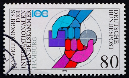 GERMANY - CIRCA 1990: a stamp printed in the Germany shows Two Arms, International Chamber of Commerce, 30th Universal Congress, circa 1990 photo