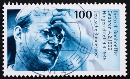 executed: GERMANY - CIRCA 1995: a stamp printed in the Germany shows Dietrich Bonhoeffer, Protestant Theologian, participant of German resistance movement against Nazism and executed in April 1945, circa 1995