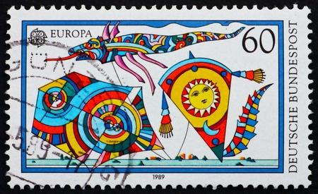 GERMANY - CIRCA 1995: a stamp printed in the Germany shows Kites, child toys, circa 1995 photo