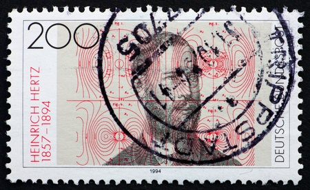 hertz: GERMANY - CIRCA 1994: a stamp printed in the Germany shows Heinrich Hertz, Electric Flux Lines, Discovery of Electromagnetic Waves by Heinrich Hertz, circa 1994