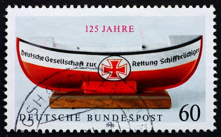 lifeboat: GERMANY - CIRCA 1990: a stamp printed in the Germany shows German Life Boat Institution, 125th Anniversary, circa 1990 Stock Photo