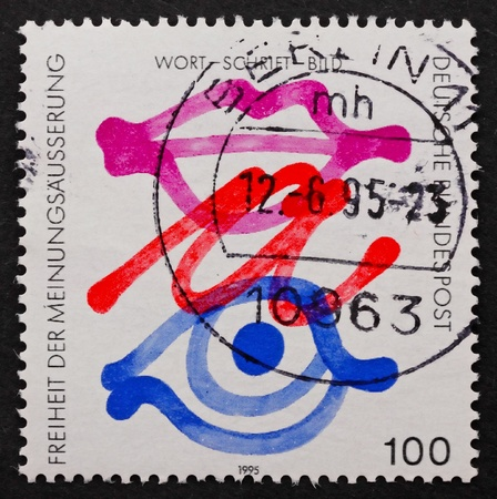GERMANY - CIRCA 1995: a stamp printed in the Germany shows Symbols for Freedom of Expression, circa 1995 photo