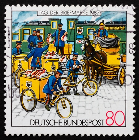 GERMANY - CIRCA 1987: a stamp printed in the Germany shows Postmen, Stamp Day, circa 1987 Stock Photo - 11455668
