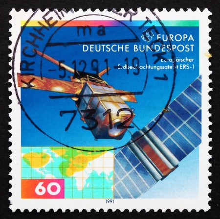 sensing: GERMANY - CIRCA 1991: a stamp printed in the Germany shows European Remote Sensing Satellite ERS-1, circa 1991