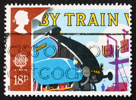 GREAT BRITAIN – CIRCA 1988: a stamp printed in the Great Britain shows Mallard Locomotive, circa 1988 photo